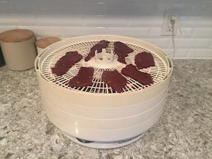 You can use a dehydrator, a smoker, or even your oven to make jerky. This is my 15 year old Nescoe Garden American Harvest which has dried hundreds of pounds of food over the years.