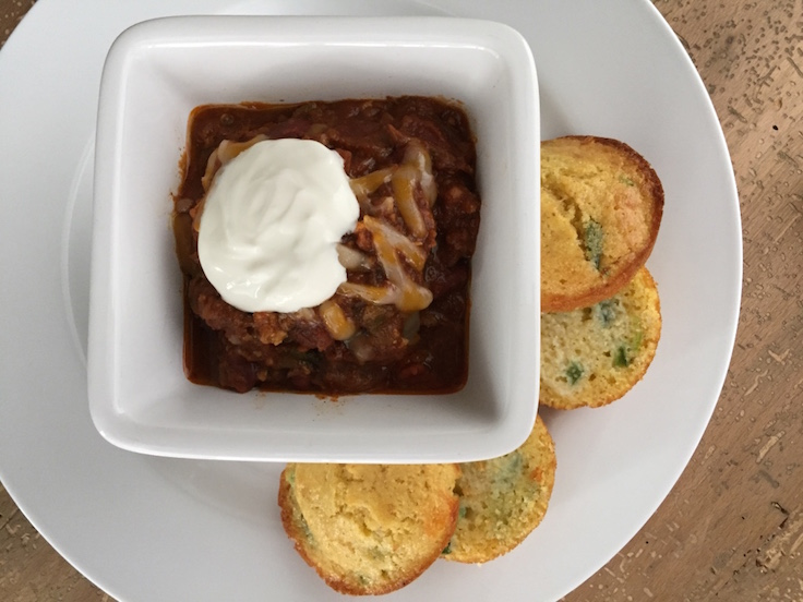 Sides and toppings make any chili - some cheddar and sour cream, and don't forget the cornbread muffins!