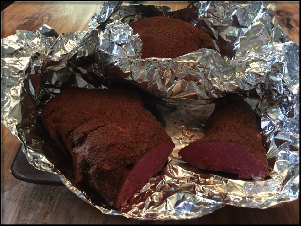Venison pastrami smoked, and cooled, ready for slicing.